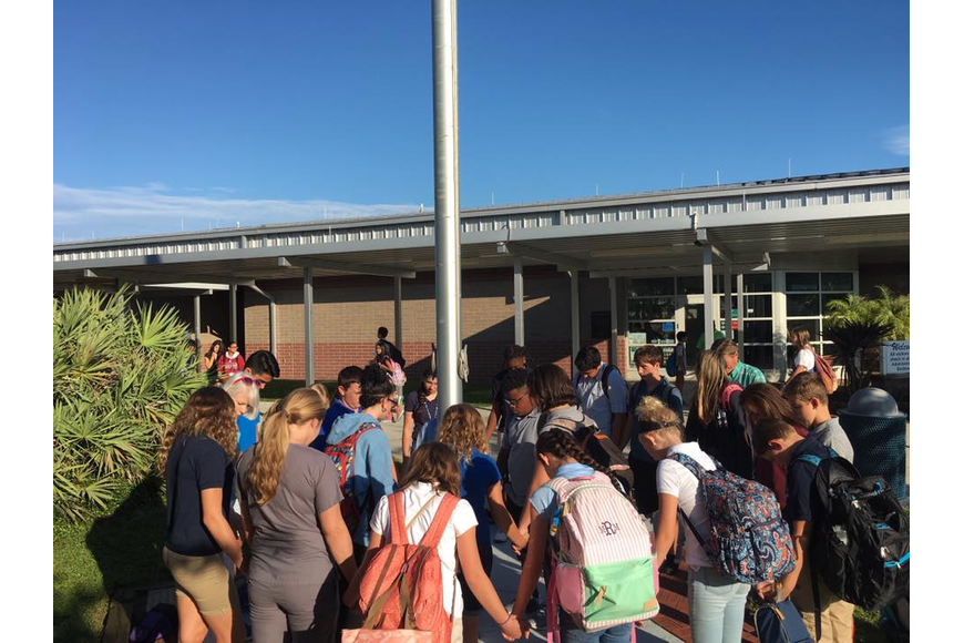 Hinson Middle School students spent a few minutes before school praying for their communities.