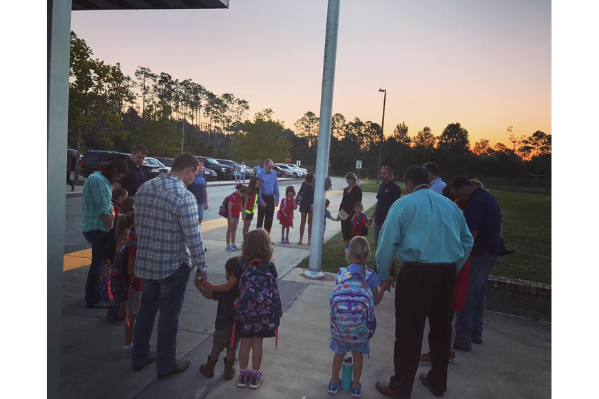 Students at Pathways Elementary School gathered around the flag pole Sept. 28 (Courtesy photos).